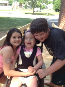 Brianna loves her big brother and sister.  She often responds to them with smiles and squeals of delight!  Although it can be difficult to have a sister with disabilities, the kids are learning lessons of compassion that take many a lifetime to understand!