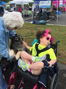 Bri met two service dogs and got to pet them!